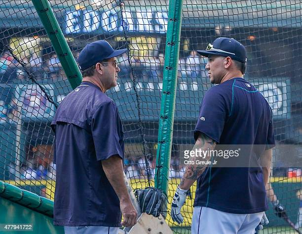 Newly hired hitting coach Edgar Martinez of the Seattle Mariners talks with Jesus Sucre prior to the game against the Houston Astros at Safeco Field...