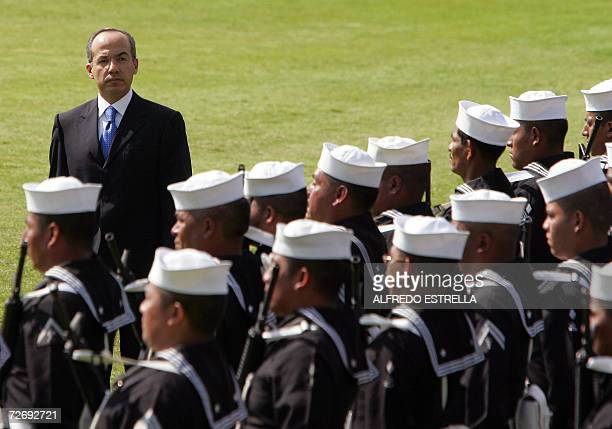 Newly inaugurated Mexican President Felipe Calderon reviews navy troops before the start of a militar parade at the Campo Marte in Mexico City...