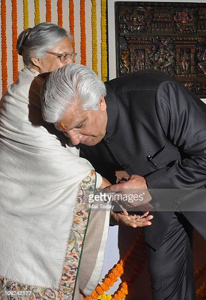 Newly inducted minister Ramakant Goswami seeking the blessings of Chief Minister during a swearingin ceremony in New Delhi on Wednesday