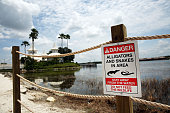 Newly installed signs warn of alligators and snakes on a closed section of beach following the death of a 2yearold boy who was killed by an alligator...