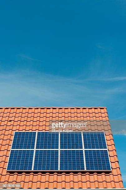 Newly installed solar panels on roof of new home, Netherlands