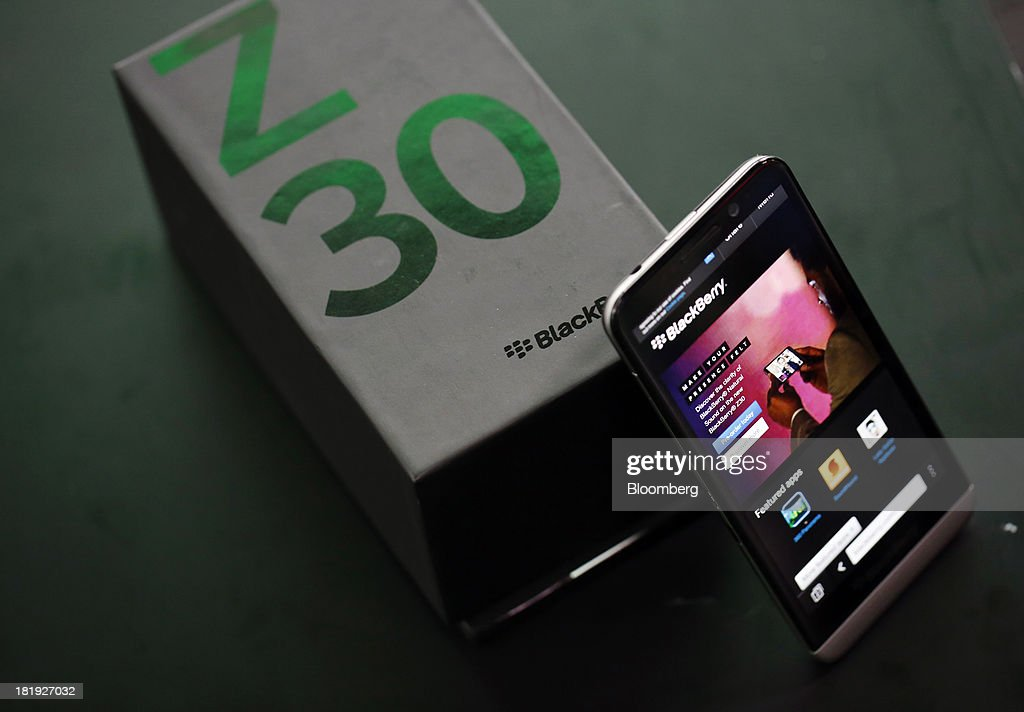 A newly launched BlackBerry Z30 smartphone, produced by BlackBerry Ltd., sits with a presentation box in this arranged photograph taken in London, U.K., on Thursday, Sept. 26, 2013. BlackBerry, the smartphone maker looking to go private in a $4.7 billion deal, is seeing support from suppliers, customers and partners wobble amid speculation the company may shut down its handset business. Photographer: Simon Dawson/Bloomberg via Getty Images