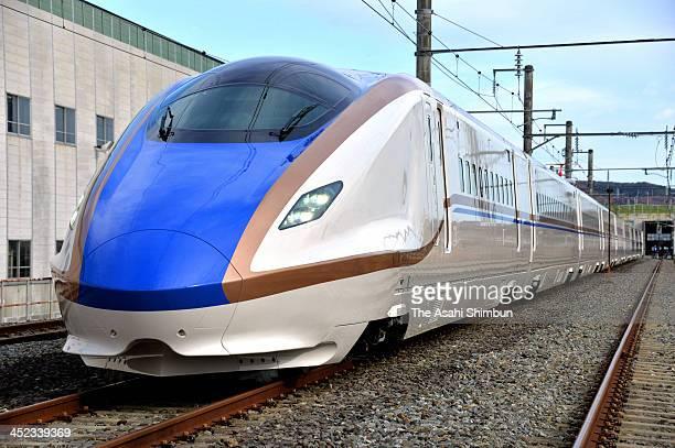 Newly launching Hokuriku Shinkansen 'E7' carriages are unveiled at the East Japan Railways Co Shinkansen Center on November 28 2013 in Rifu Miyagi...