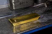 A newly manufactured 400 ounce gold bar sits on a workbench at a precious metal refinery near Mendrisio Switzerland on Thursday Nov 21 2013 Precious...