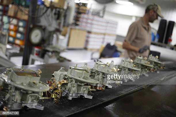 Newly manufactured carburetors move down a conveyor belt on an assembly line at the Holley Performance Products Inc manufacturing facility in Bowling...