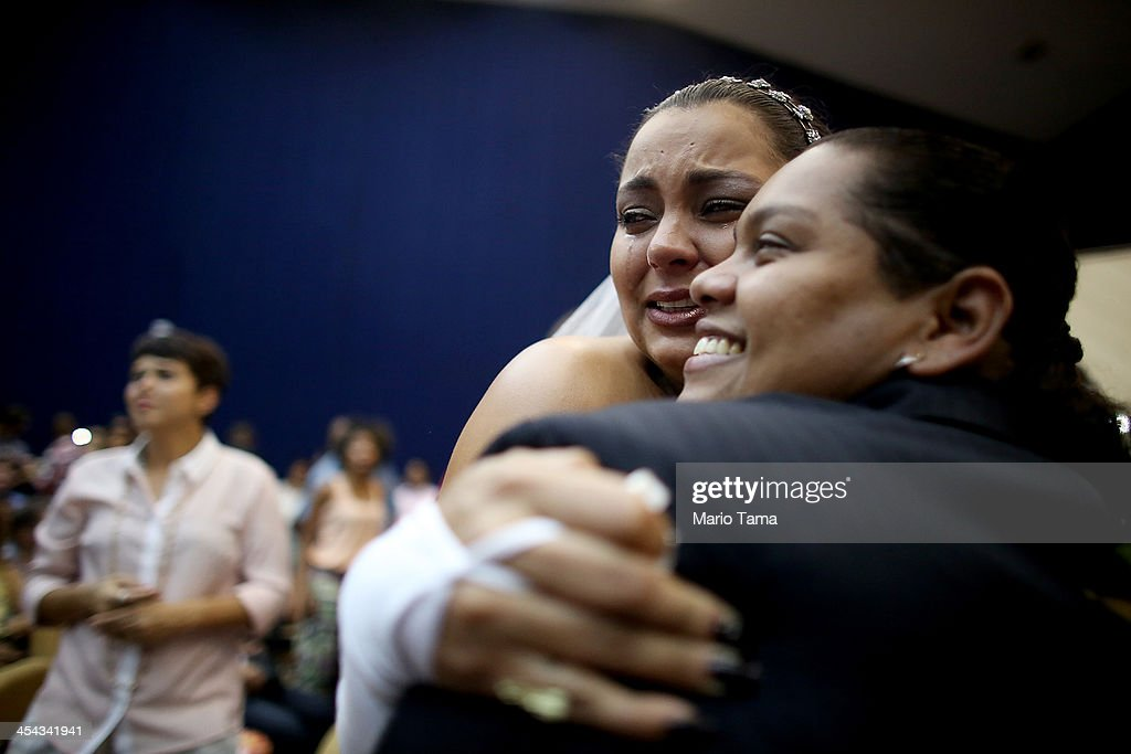 Newly married couple Ana Paula and Juliana (R) react at what was billed as the world's largest communal gay wedding on December 8, 2013 in Rio de Janeiro, Brazil. 130 couples were married at the event which was held at the Court of Justice in downtown Rio. In May, Brazil became the third country in Latin America to effectively approve same-sex marriage via a court ruling, but a final law has yet to be passed.
