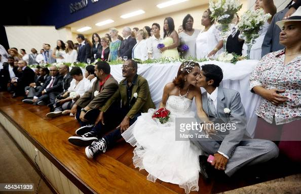 Newly married couple Emmanuela and Romilda kiss at what was billed as the world's largest communal gay wedding on December 8 2013 in Rio de Janeiro...