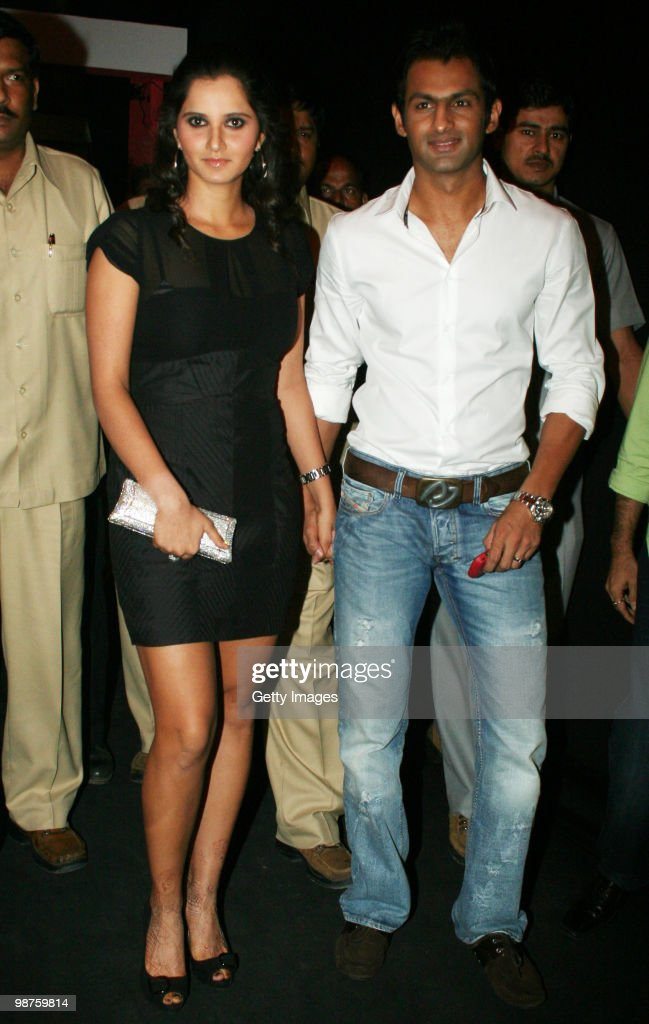 Newly married couple Indian tennis ace Sania Mirza and her Pakistani cricketer husband Shoaib Malik arrive for the launch of Italian fashion brand Diesel on April 29, 2010 in Mumbai, India.