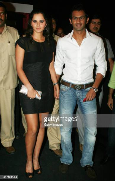 Newly married couple Indian tennis ace Sania Mirza and her Pakistani cricketer husband Shoaib Malik arrive for the launch of Italian fashion brand...