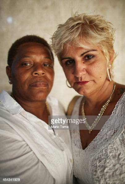 Newly married couple Nelzete and Danisa together for three years pose at what was billed as the world's largest communal gay wedding on December 8...
