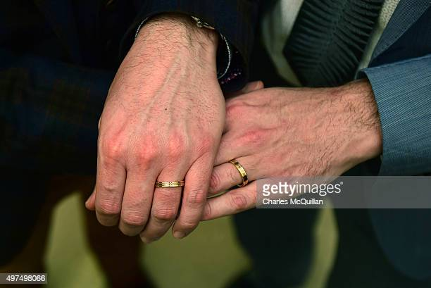 Newly married couple Richard Dowling and Cormac Gollogly display their wedding rings after the first ever same sex marriage takes place on November...