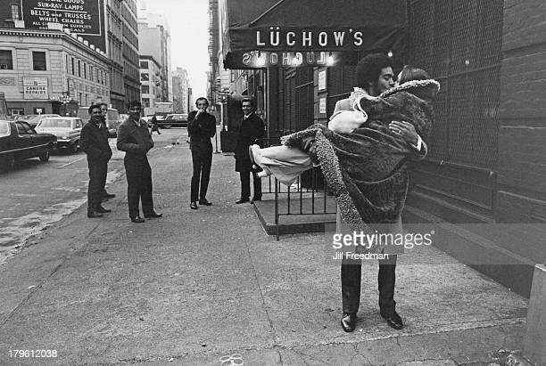 A newly married couple share a kiss outside Luchow's restaurant on East 14th Street New York City 1970
