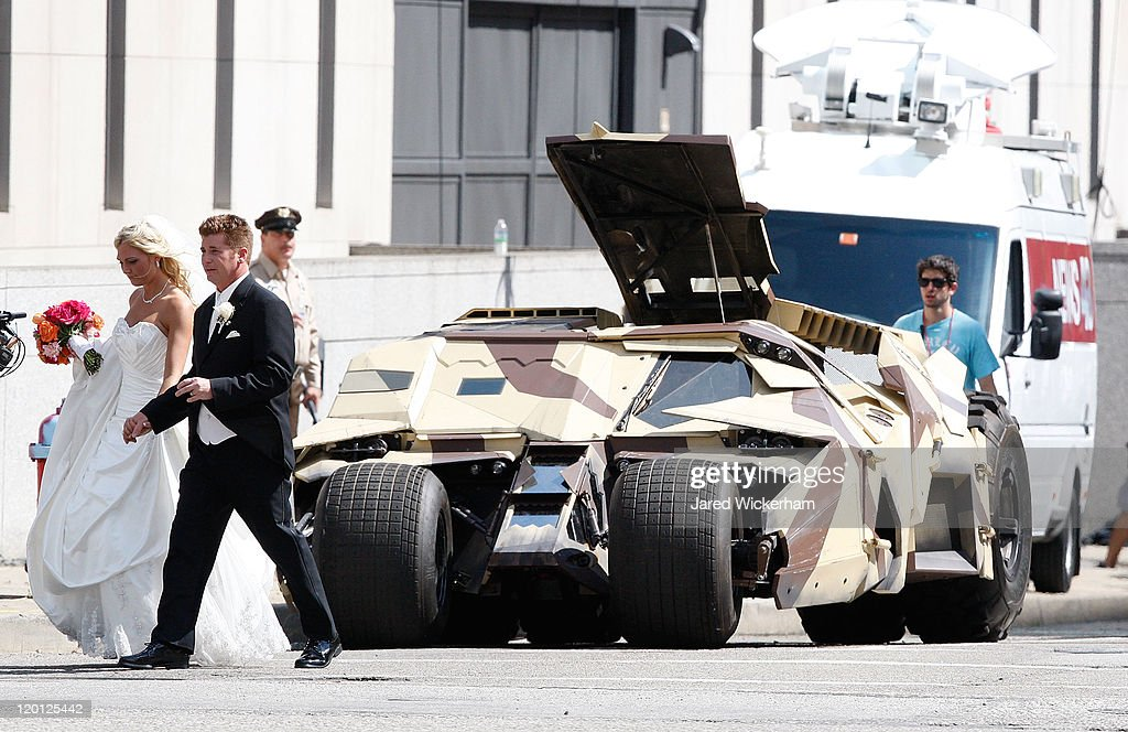 A newly married couple walk by the Tumbler after their wedding at a church across the street from the set of 'The Dark Knight Rises' filming near the Carnegie Mellon University Software Engineering Institute Building in the neighborhood of Oakland on July 30, 2011 in Pittsburgh, Pennsylvania..