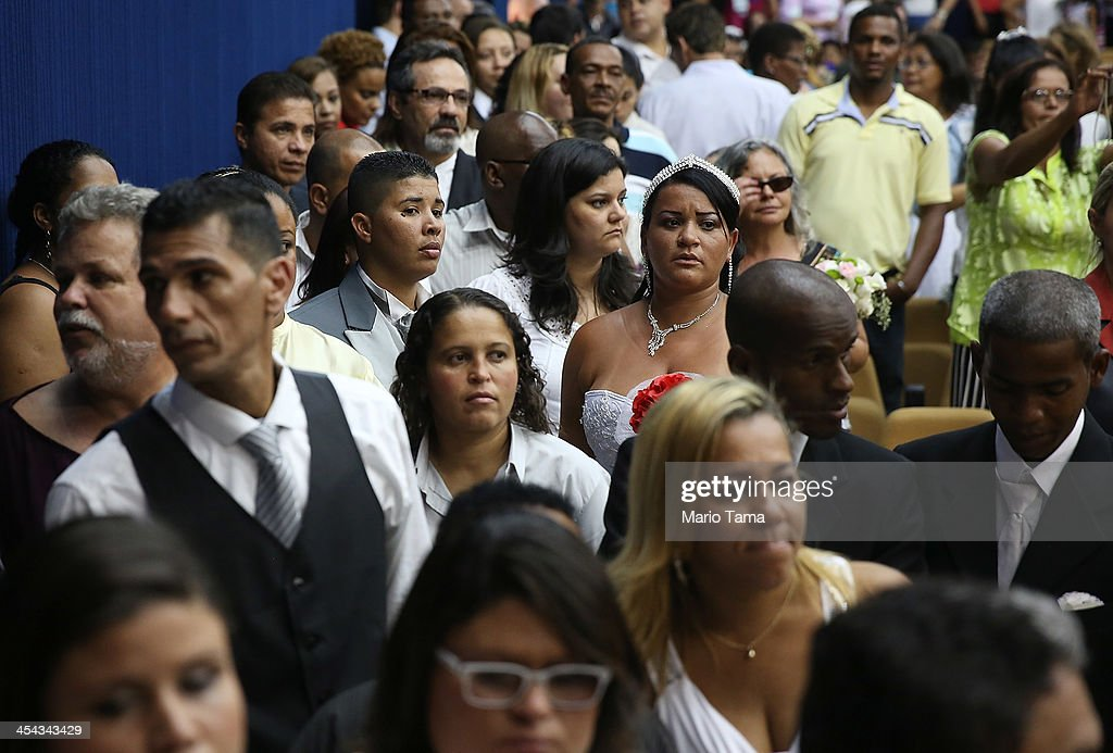 Newly married couples line up to be photographed on stage at what was billed as the world's largest communal gay wedding on December 8, 2013 in Rio de Janeiro, Brazil. 130 couples were married at the event which was held at the Court of Justice in downtown Rio. In May, Brazil became the third country in Latin America to effectively approve same-sex marriage via a court ruling, but a final law has yet to be passed.
