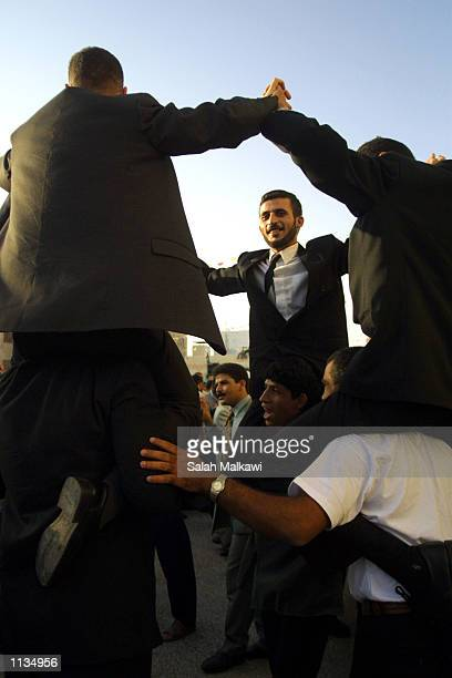 Newly married grooms dance to celebrate their recent Muslim mass wedding ceremony July 19 2002 in Amman Jordan Fiftyfive Muslim couples participated...