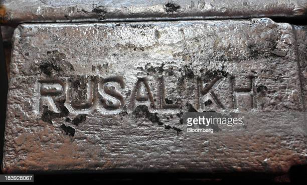 A newly moulded aluminum ingot displays the company logo of United Co Rusal Plc at the Impol Seval AD plant in Sevojno Serbia on Wednesday Oct 9 2013...