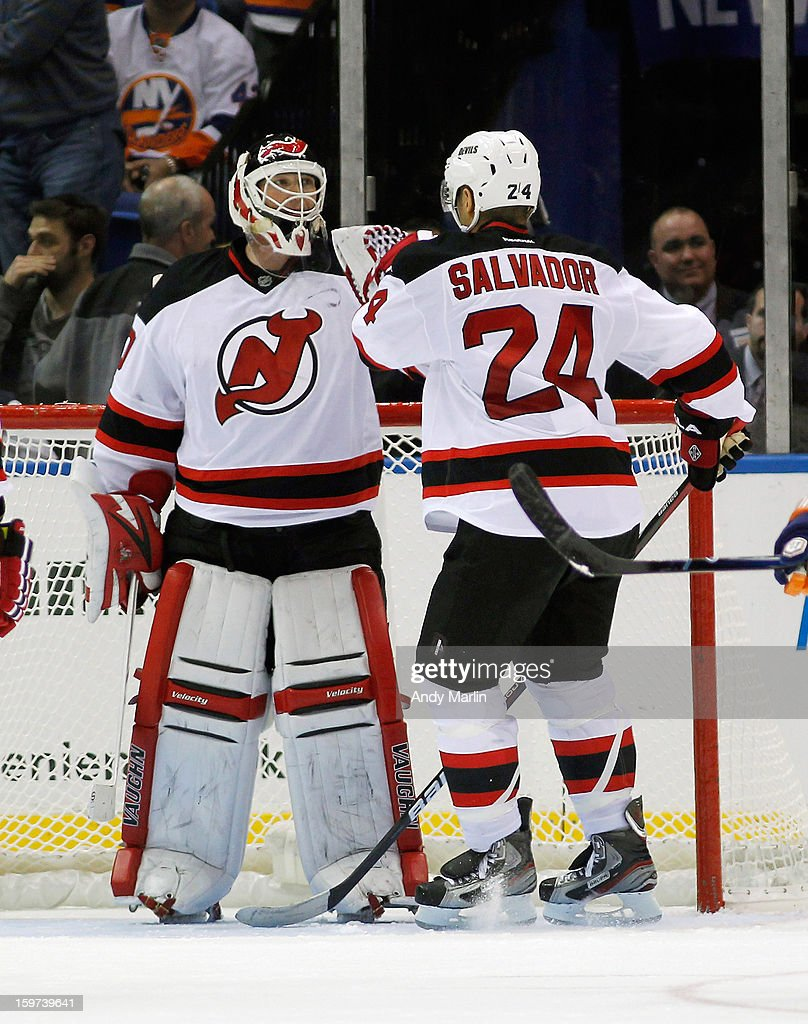Newly named captain Bryce Salvador #24 of the New Jersey Devils congratulates winning goaltender Martin Brodeur #30 after the Devils defeated the Islanders at the Nassau Coliseum on January 19, 2013 in Uniondale, New York. The Devils defeated the Islanders 2-1.