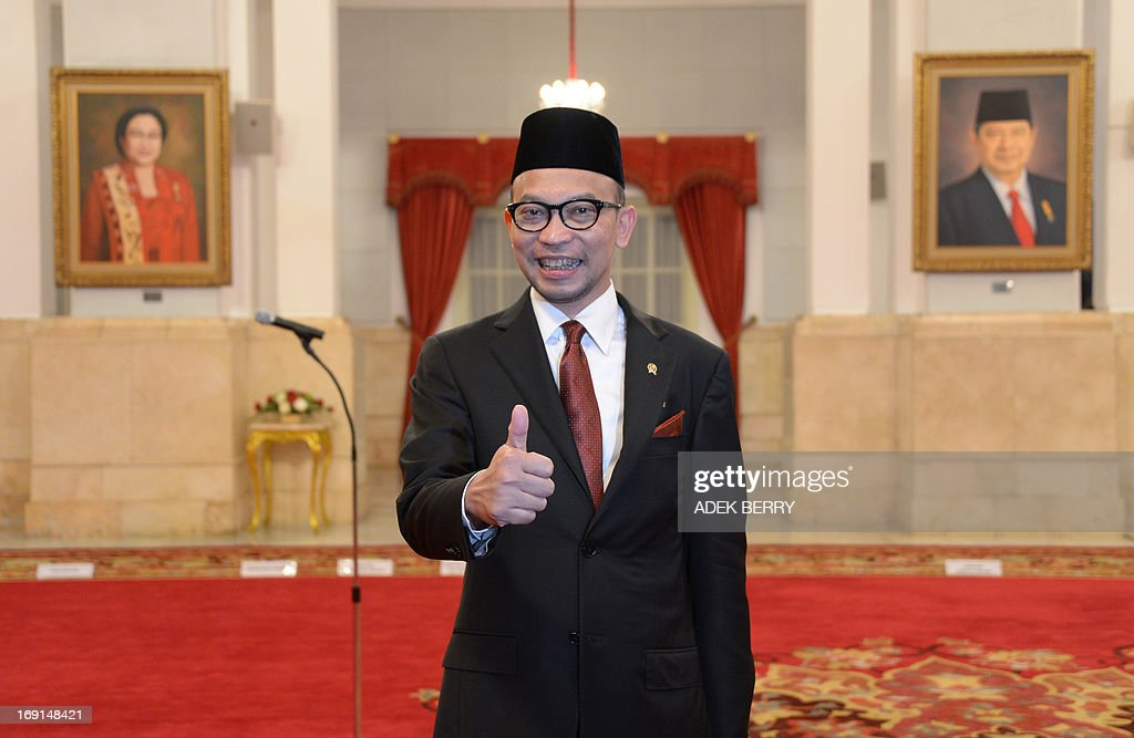 Newly oppointed Finance Minister Chatib Basri thumbs up prior to an inauguration ceremony at the presidential palace in Jakarta on May 21, 2013. Basri, 47, who was the head of Indonesia's Investment Coordinating Board (BKPM) before his appointment, takes up the job as economic growth slows, the rupiah remains weak, the current account deficit widens and the government is poised to take the politically sensitive step of hiking fuel prices.