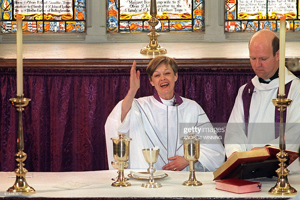 Newly ordained Reverend Carolyn Walling give the blessing to the congregation of St Mary's Battersea 13 March 1994 in London becoming one of the...