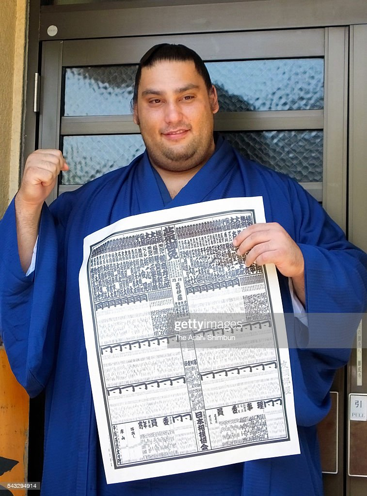 Newly promoted Brazilian sekiwake Kaisei poses for photographs during a press conference after the new Sumo ranking announced at an accommodation of Tomozuna Stable ahead of the Grand Sumo Nagoya Tournament on June 27, 2016 in Nagoya, Aichi, Japan.