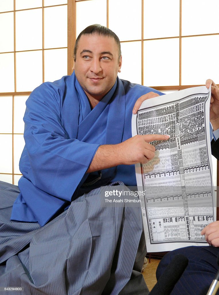 Newly promoted Georgian sekiwake Tochinoshin poses for photographs during a press conference after the new Sumo ranking announced at an accommodation of Kasugano Stable ahead of the Grand Sumo Nagoya Tournament on June 27, 2016 in Kasugai, Aichi, Japan.