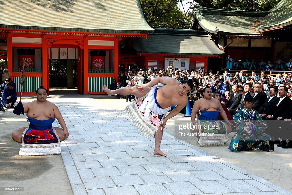 Newly promoted Mongolian yokozuna, sumo champion Harumafuji, whose real name is Davaanyamyn Byambadorj, performs 'Dohyo-iri', ring-purification ritual at Sumiyoshi Shrine on November 3, 2012 in Fukuoka, Japan.