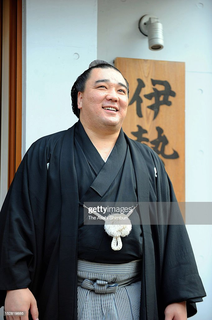Newly promoted Mongolian Yokozuna Sumo grand champion Harumafuji poses for photographs at Isegahama Stable on September 26 2012 in Tokyo Japan