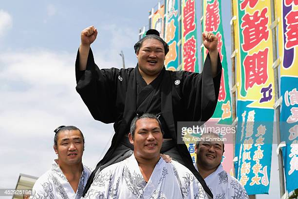 Newly promoted Ozeki second highest rank in sumo Goeido poses for photographs after the ceremony on July 30 2014 in Fuso Aichi Japan