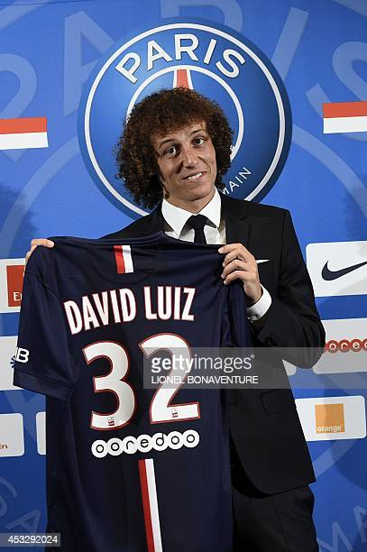 PSG newly recruited Brazilian defender David Luiz poses with his jersey during his official presentation on August 7 2014 in Paris Luiz aged 27...