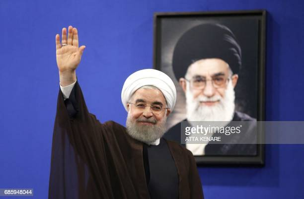 Newly reelected Iranian President Hassan Rouhani gestures after delivering a televised speech in the capital Tehran on May 20 2017 Iranians have...
