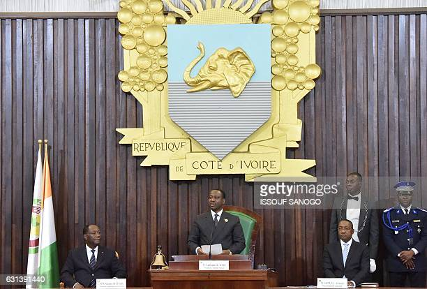Newly reelected Ivorian National Assembly president Guillaume Soro speaks as President Alassane Ouattara looks on during the nomination by the...