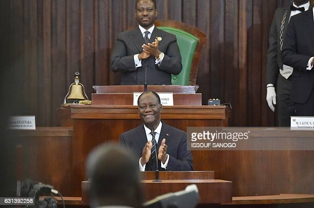 Newly reelected Ivorian National Assembly president Guillaume Soro and President Alassane Ouattara applaud during the nomination by the Ivorian...