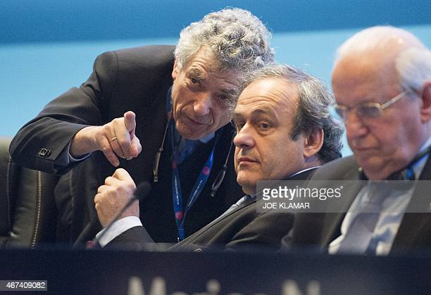 Newly reelected UEFA president Michel Platini speaks to Angel Maria Villar Llona at the Ordinary UEFA Congress in Vienna Austria on March 24 2015 The...