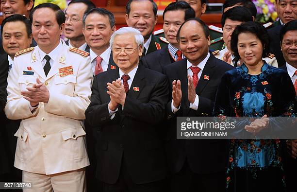 Newly reelected Vietnam Communist Party Secretary General Nguyen Phu Trong is flanked by Politburo members Tran Dai Quang Nguyen Xuan Phuc and Nguyen...