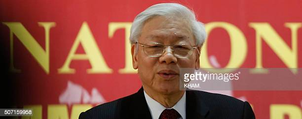 Newly reelected Vietnam Communist Party Secretary General Nguyen Phu Trong speaks as a press conference after the closing ceremony on the final day...