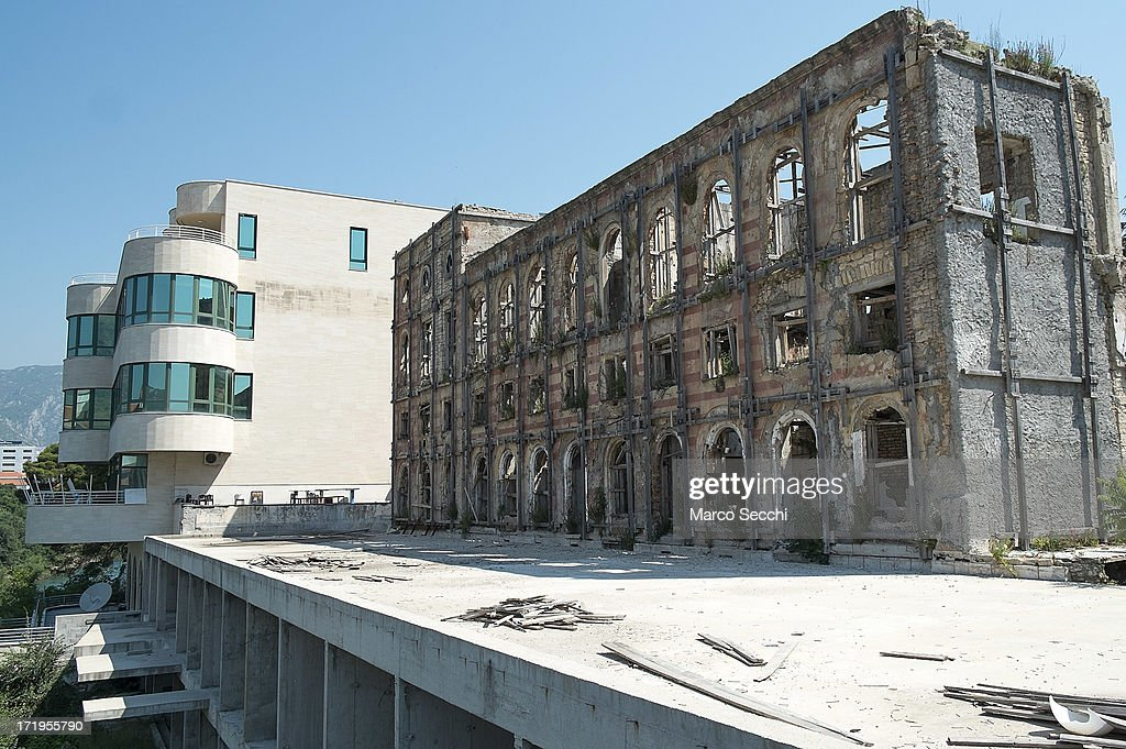 A newly refurbished building is seen next to a derelict hotel as the city of Mostar remembers the 1993 conflict on June 28, 2013 in Mostar, Bosnia and Herzegovina. The Siege of Mostar peaked in 1993 during the Croat-Bosniak conflict lasting eighteen months as fighting took place as Bosnia and Herzegovina declared independence from Yugoslavia. The city was divided in half between the two battling armies. Mostar, dating back over four hundred years, was mostly destroyed through the fighting. Although reconstruction has slowly commenced in the last decades, evidence of the war remains in bullet ravaged buildings still standing throughout the city.