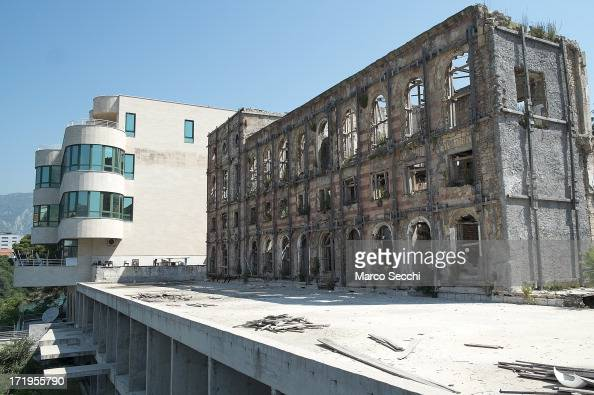 A newly refurbished building is seen next to a derelict hotel as the city of Mostar remembers the 1993 conflict on June 28 2013 in Mostar Bosnia and...