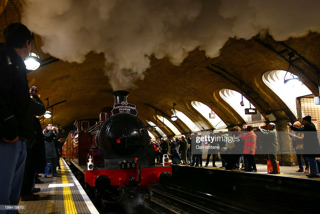 A newly restored steam engine built in 1898, known as Met Locomotive No. 1, departs Baker Street Underground station in a recreation of the first London Underground journey on January 13, 2013 in London, England. The London Underground celebrates its 150th birthday this month, the Metropolitan line being the first stretch between Paddington and Farringdon stations.