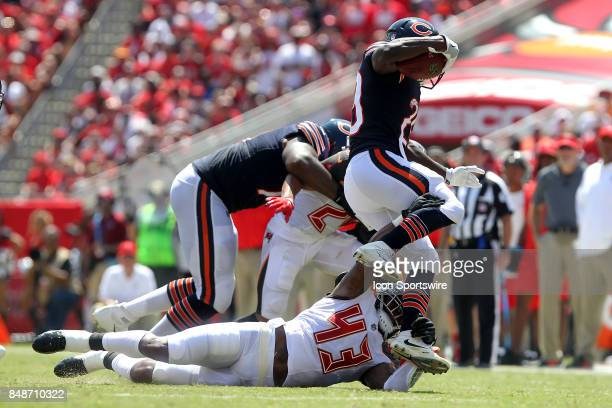 Newly signed Buccaneers safety T J Ward brings down Tarik Cohen of the Bears during the NFL Regular game between the Chicago Bears and the Tampa Bay...