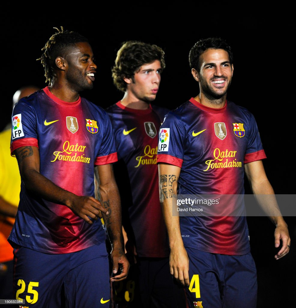Newly signed FC Barcelona player <a gi-track='captionPersonalityLinkClicked' href=/galleries/search?phrase=Alex+Song&family=editorial&specificpeople=652067 ng-click='$event.stopPropagation()'>Alex Song</a> jokes with his new teammate Cesc Fabregas prior to the Joan Gamper Trophy friendly match between FC Barcelona and Sampdoria at Camp Nou on August 20, 2012 in Barcelona, Spain.