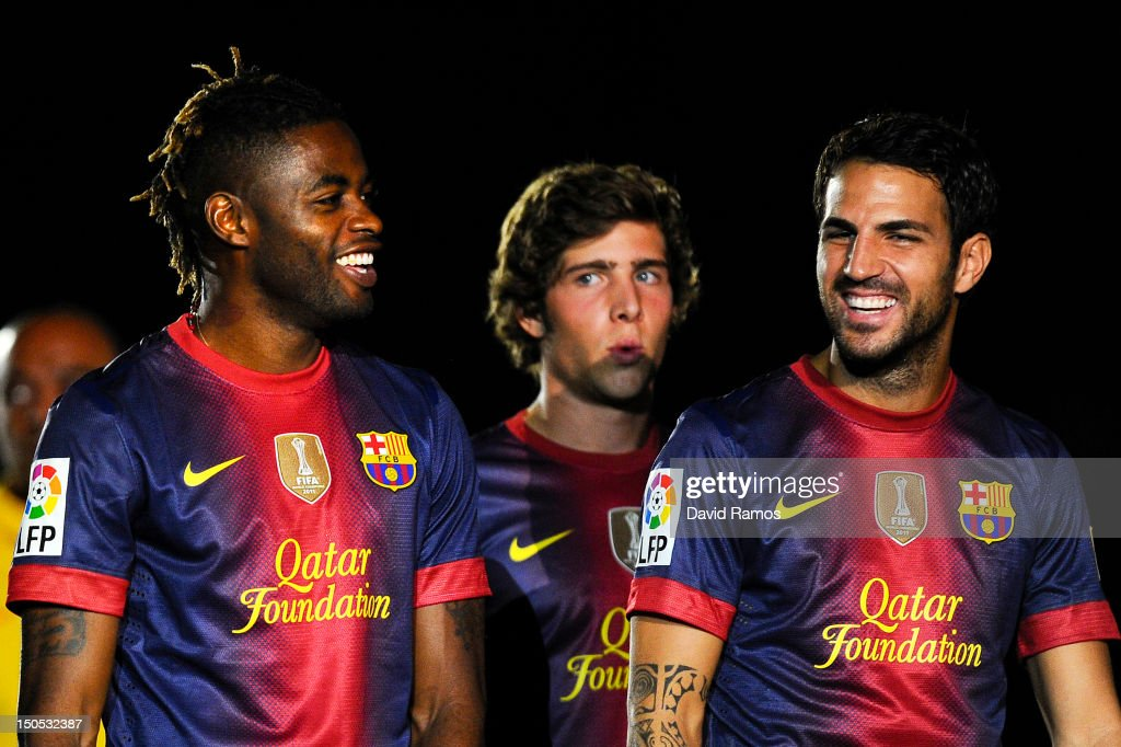 Newly signed FC Barcelona player Alex Song jokes with his new teammate Cesc Fabregas prior to the Joan Gamper Trophy friendly match between FC Barcelona and Sampdoria at Camp Nou on August 20, 2012 in Barcelona, Spain.