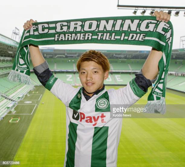 Newly signed FC Groningen midfielder Ritsu Doan poses for a photo in Groningen the Netherlands on June 29 with the club's stadium in the background...