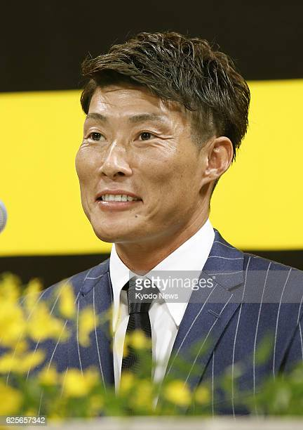 Newly signed Hanshin Tigers outfielder Yoshio Itoi attends a press conference in Osaka on Nov 25 2016 Itoi was one of the most soughtafter free...