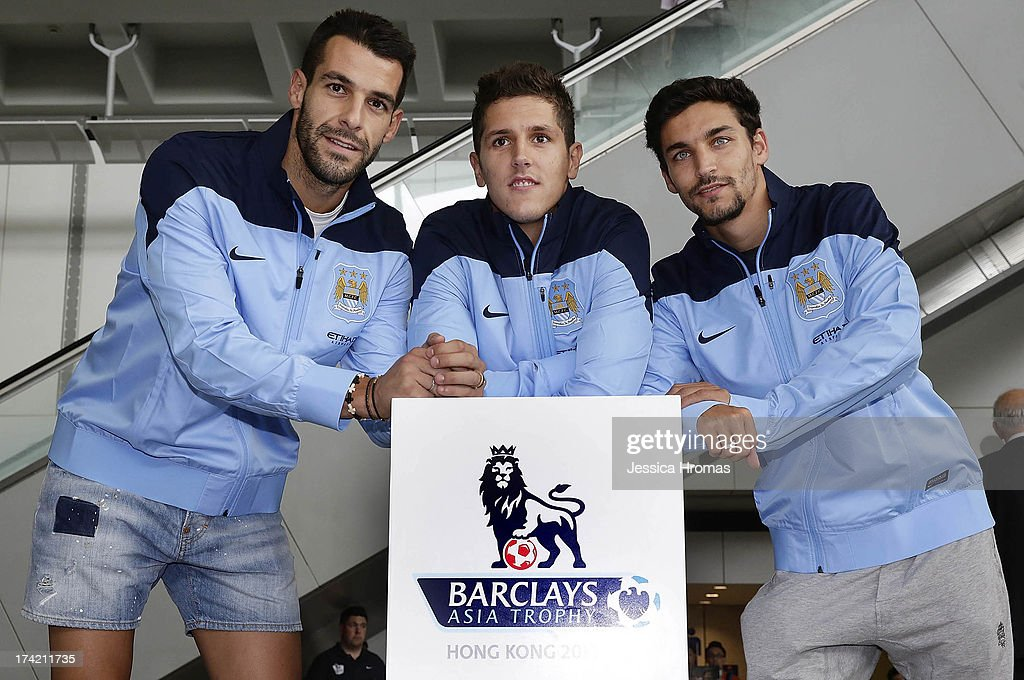 Newly signed Manchester City players <a gi-track='captionPersonalityLinkClicked' href=/galleries/search?phrase=Alvaro+Negredo&family=editorial&specificpeople=4085785 ng-click='$event.stopPropagation()'>Alvaro Negredo</a>, Stevan Jovetic and Jesus Navas pose for a photo at Hong Kong Airport as they arrive to compete in the Barclays Asia Trophy, on July 22, 2013 in Hong Kong.