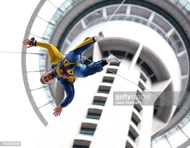 Newly signed member of the New Zealand Warriors Sam Tomkins makes his jump off the Auckland Skytower on December 11 2013 in Auckland New Zealand