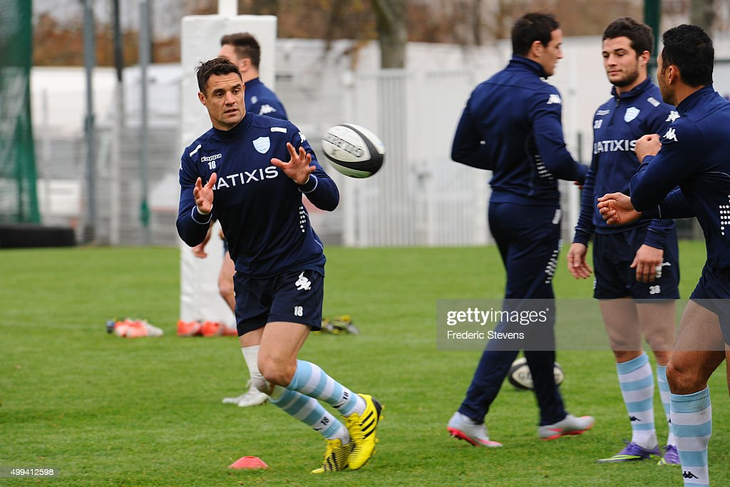 Newly signed player <a gi-track='captionPersonalityLinkClicked' href=/galleries/search?phrase=Dan+Carter+-+Rugby+Player&family=editorial&specificpeople=171299 ng-click='$event.stopPropagation()'>Dan Carter</a> (C) warms-up with teammates <a gi-track='captionPersonalityLinkClicked' href=/galleries/search?phrase=Brice+Dulin&family=editorial&specificpeople=7045962 ng-click='$event.stopPropagation()'>Brice Dulin</a> (R) during a Racing 92 training session on December 1, 2015 in Le Plessis-Robinson, France.