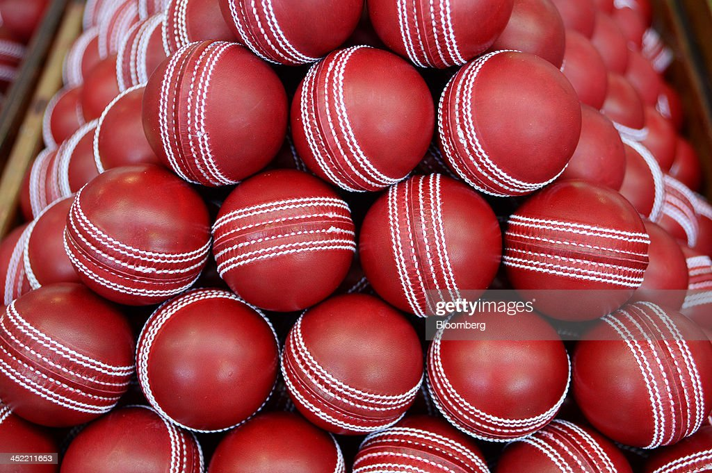 Newly stitched red cricket balls sit in a crate as they await branding at the Kookaburra Sports Pty Ltd. plant in Melbourne, Australia, on Tuesday, Nov. 26, 2013. Australian businesses need to boost efficiency to maintain growth in living standards, Reserve Bank of Australia Deputy Governor Philip Lowe said. Photographer: Carla Gottgens/Bloomberg via Getty Images