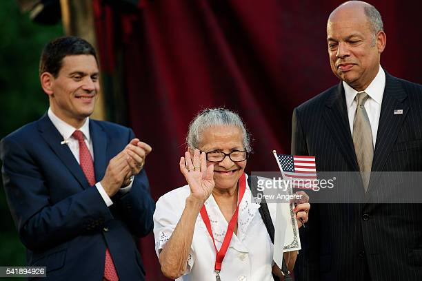Newly sworn in American citizen Fracisca Garcia from Cuba waves after accepting her Certificate of Naturalization from Jeh Johnson Secretary of the...