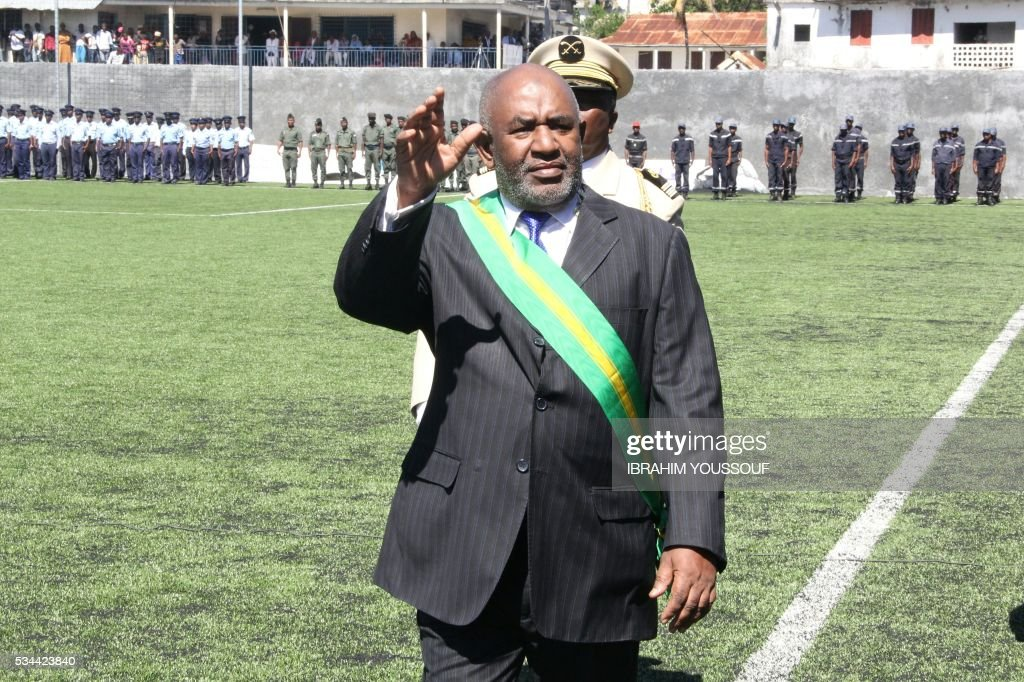 Newly sworn in Comoros President Azali Assoumani waves to the public at the Moroni Stadium at the end of the Presidential Swearing in ceremony on May 26, 2016 in Moroni, Comoros. / AFP / IBRAHIM