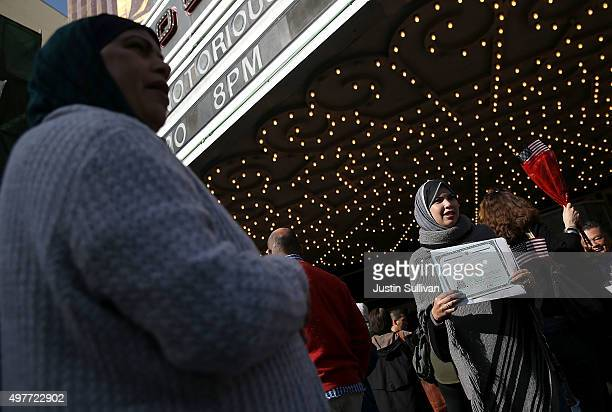 Newly sworn in US citizen Doaa Ahmed Khairat Elbeialy of Egypt holds her certificate of citizenship after a naturalization ceremony at the Paramount...